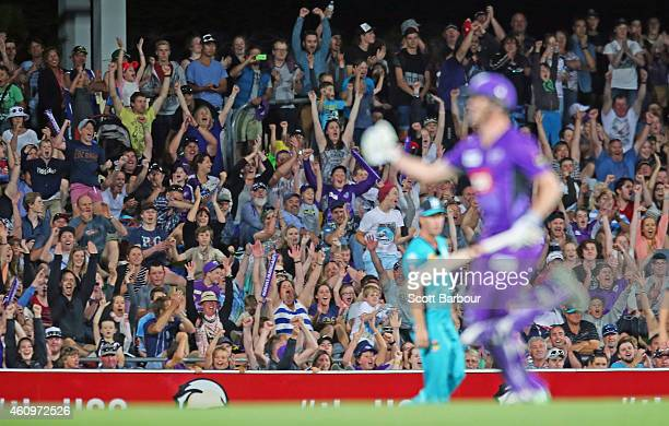 The crowd celebrates as George Bailey of the Hurricanes hits the winning runs during the Big Bash League match between the Hobart Hurricanes and the...