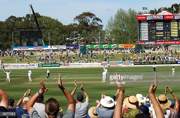 The crowd cheer as Matthew Hayden of Australia celebrates scoring 376 runs during the second day of the first 3 Test match between Australia and...