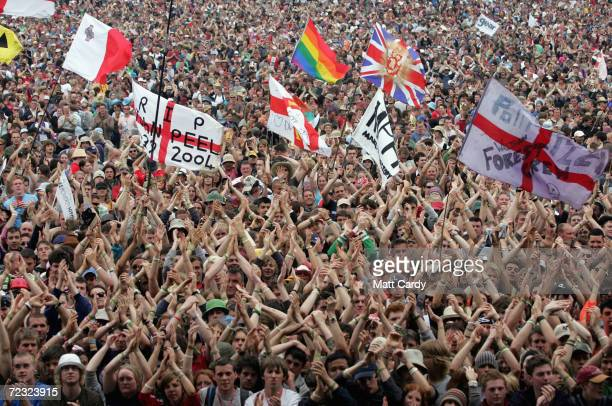 The crowd cheer Sir Bob Geldof LIVE 8 organiser as he invites the festival crowd to link hands in support of the Make Poverty History campaign on the...