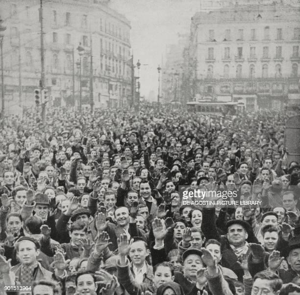 The crowd cheering Francoist troops Puerta del Sol Madrid Spain Spanish Civil war from L'Illustrazione Italiana Year LXVI No 15 April 9 1939