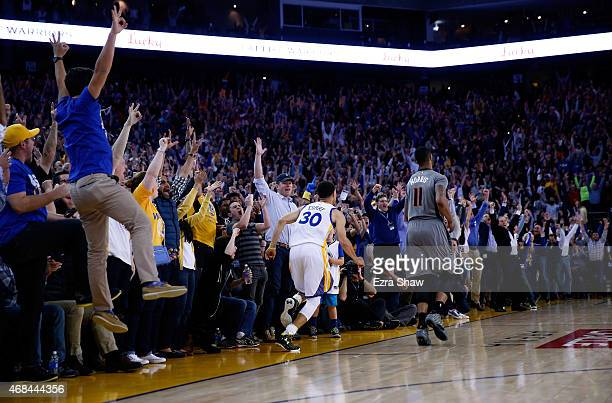 The crowd cheers after Stephen Curry of the Golden State Warriors made a threepoint basket in the final minute of their game against the Phoenix Suns...