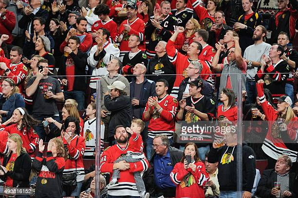 The crowd cheers after the Chicago Blackhawks scored against the Florida Panthers in the second period of the NHL game at the United Center on...