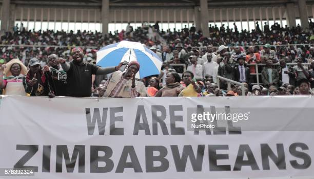 The crowd cheers and dances at the presidential inauguration ceremony of Emmerson Mnangagwa in Harare Zimbabwe Friday November 24 2017 Mnangagwa is...