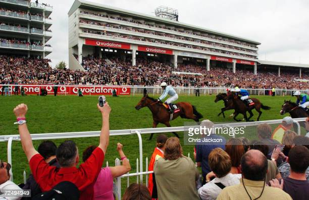 The crowd cheers as Kieran Fallon comes up to the finish line to win the Vodafone Derby one of the biggest horse races of the year at Epsom...