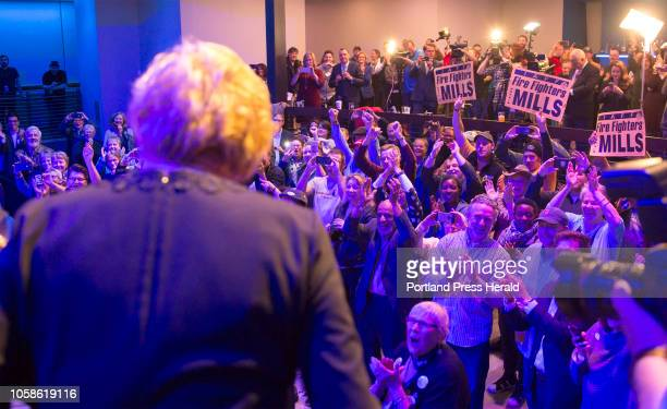 The crowd cheers as Maine's newly elected governor Janet Mills comes on stage for her victory speech at the Maine Democrats election night party for...