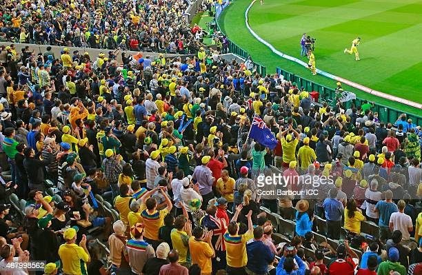 The crowd cheers as Michael Clarke of Australia walks out to bat in his final one day inetrnational match for Australia during the 2015 ICC Cricket...