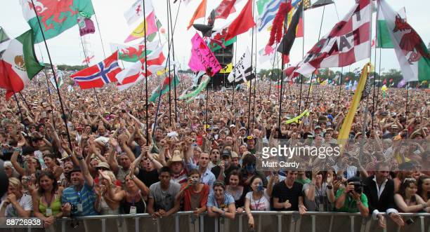 The crowd cheers as Tom Jones performs on the main Pyramid Stage at the Glastonbury Festival at Worthy Farm, Pilton on June 28, 2009 near...