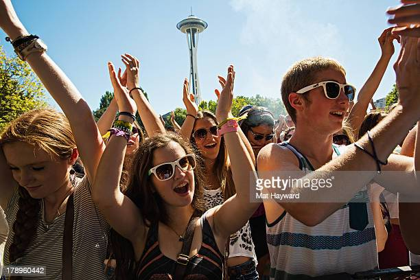 The crowd cheers during the Bumbershoot Music Festival at Seattle Center on August 31 2013 in Seattle Washington