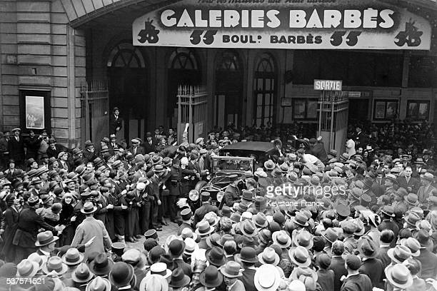 The crowd cheers the presence of the famous American aviator Amelia Earhart and her husband George P Putnam in front of the galleries Barbes on June...