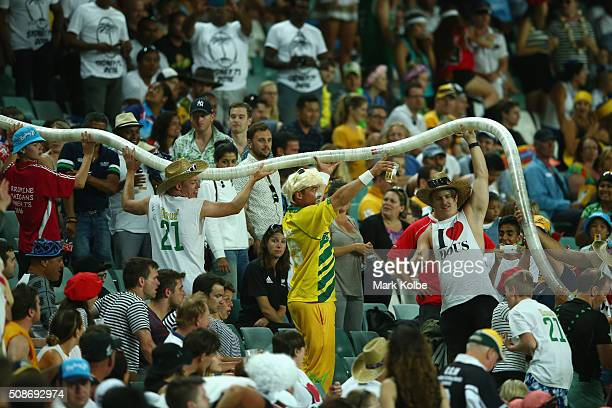 The crowd create a beer cup snake in the crowd during the match between England and the USA at the 2016 Sydney Sevens at Allianz Stadium on February...