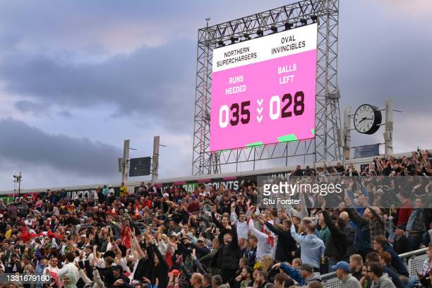 The crowd do a mexican wave in the Western Terrace during The Hundred match between Northern Superchargers Men and Oval Invincibles Men at Emerald...