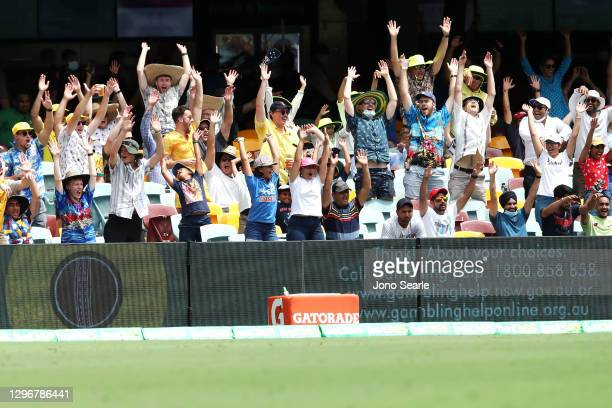 The crowd do the wave during day three of the 4th Test Match in the series between Australia and India at The Gabba on January 17, 2021 in Brisbane,...