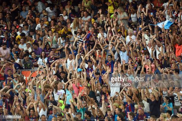 The crowd do the wave during the 54th Joan Gamper Trophy friendly football match between Barcelona and Arsenal at the Camp Nou stadium in Barcelona...