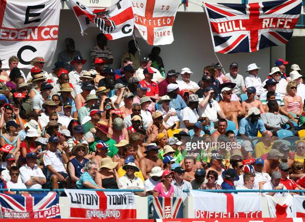 The crowd enjoy the action on Day One of the 4th Test between the West Indies and England played at The Kensington Oval on 26 February 2009 in...