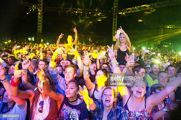 The crowd enjoy the atmosphere as Craig David performs onstage headlining the dance tent at the end of day 1 of V Festival 2016 at Weston Park on...