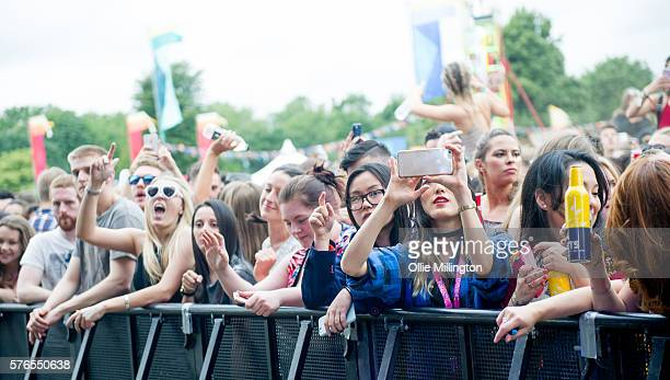 The crowd enjoy the atmosphere on Day 1 of Lovebox Festival at Victoria Park on July 15 2016 in London England