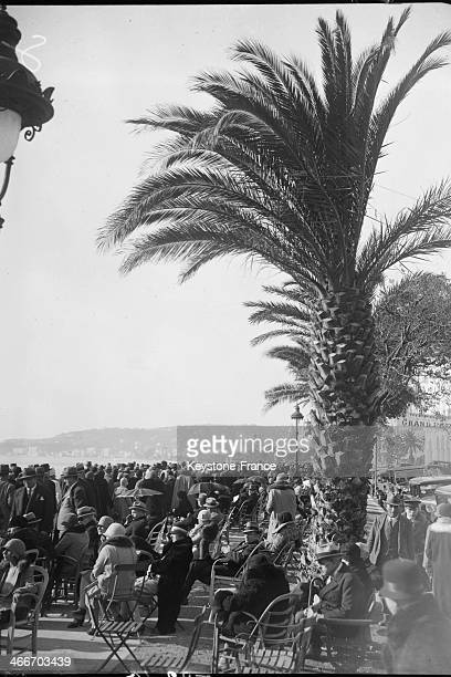 The crowd enjoying the sun on a winter day on the Promenade des Anglais on January 21 1929 in Nice France