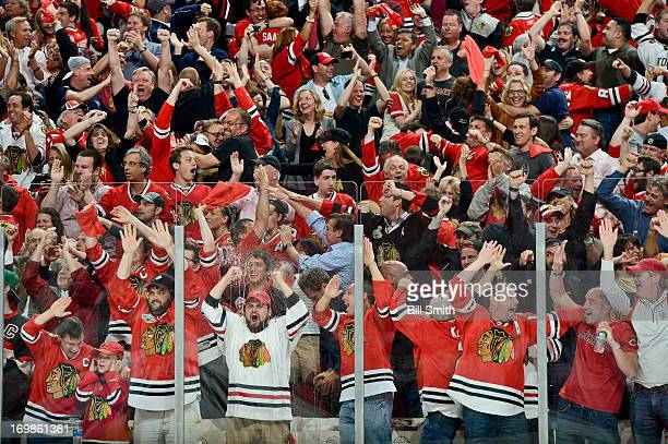 The crowd erupts in cheers after the Chicago Blackhawks scores against the Detroit Red Wings in Game Seven of the Western Conference Semifinals...