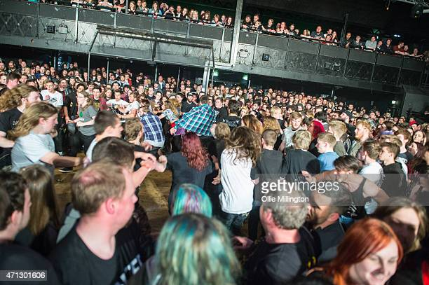 The crowd form a mosh pit cirlce pit as Cancer Bats performs on stage during the bands headline show at Dot To Dot 2015 onstage at Rock City on April...