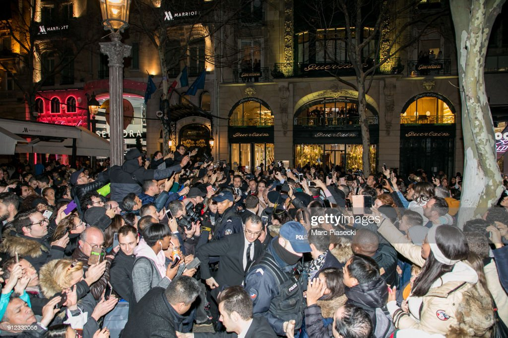 The crowd gather to see actress Angelina Jolie in front of the 'Guerlain' store on the Champs-Elysees avenue on January 30, 2018 in Paris, France.