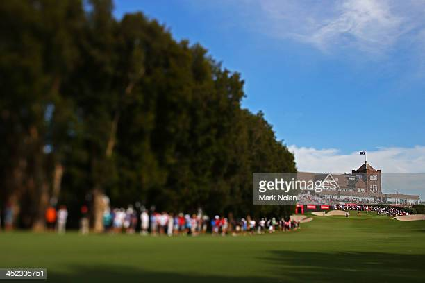 The crowd gathers along the 18th hole up to the club house during day one of the 2013 Australian Open at Royal Sydney Golf Club on November 28 2013...