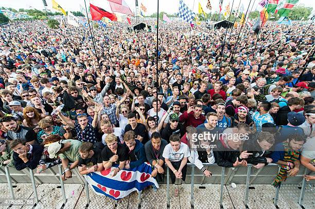 The crowd gathers before Paul Weller performs on the Pyramid Stage at the Glastonbury Festival at Worthy Farm Pilton on June 28 2015 in Glastonbury...