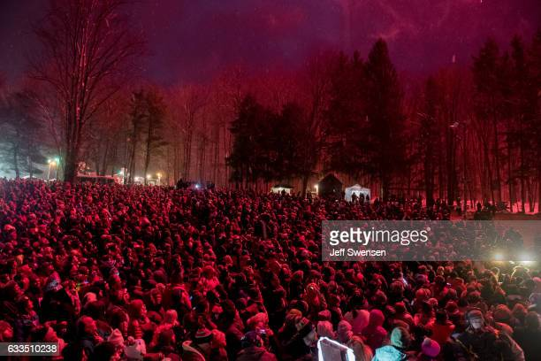 The crowd gathers during the Groundhog Day festivities where Punxsutawney Phil saw his shadow predicting six more weeks of winter during 131st annual...