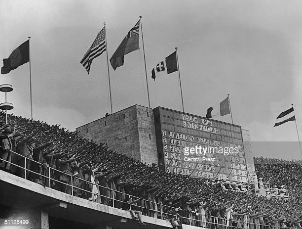 The crowd gives the Nazi salute at the Berlin Olympic games August 1936 On the scoreboard are the results of the men's 1500 metre final
