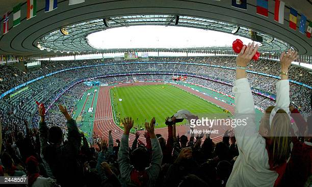 The crowd goes wild in the Stade de France stadium at the 9th IAAF World Athletics Championship August 30 2003 in Paris France