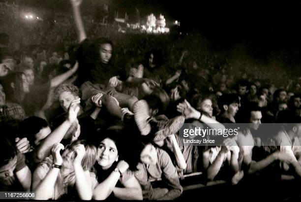 The crowd has formed a mosh pit and some surf the audience as bassist and vocalist Kim Gordon guitarist Lee Renaldo guitarist and vocalist Thurston...