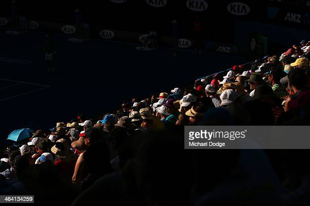 The crowd in Rod Laver Arena watches David Ferrer of Spain in his quarterfinal match against Tomas Berdych of the Czech Republic during day nine of...