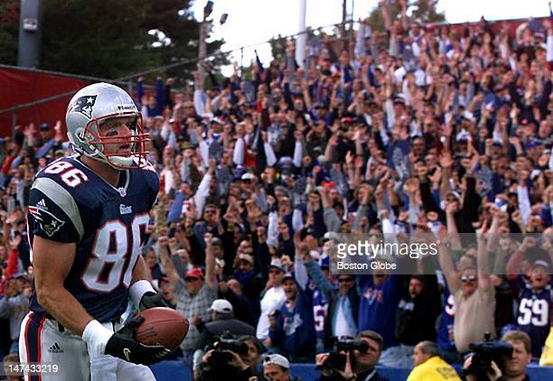 The crowd in the north end zone goes wild after Patriots tight end Eric Bjornson hauled in a touchdown pass from Drew Bledsoe.