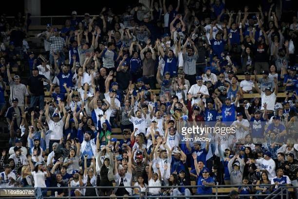 The crowd in the outfield does the wave while the New York Yankees play the Los Angeles Dodgers at Dodger Stadium on August 23, 2019 in Los Angeles,...