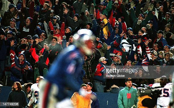 The crowd in the stands goes wild as they react to Drew Bledsoe foreground throwing the game winning touchdown pass to Ben Coates with no time on the...
