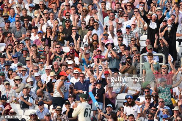 The crowd interact with Australia's Nathan Lyon during play on the third day of the fifth Ashes cricket Test match between England and Australia at...