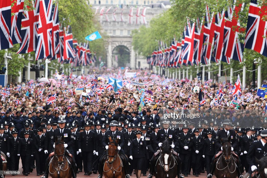 The crowd is escorted down The Mall during the Diamond Jubilee carriage procession after the service of thanksgiving at St.Paul's Cathedral on the Mall on June 5, 2012 in London, England. For only the second time in its history the UK celebrates the Diamond Jubilee of a monarch. Her Majesty Queen Elizabeth II celebrates the 60th anniversary of her ascension to the throne. Thousands of wellwishers from around the world have flocked to London to witness the spectacle of the weekend's celebrations.