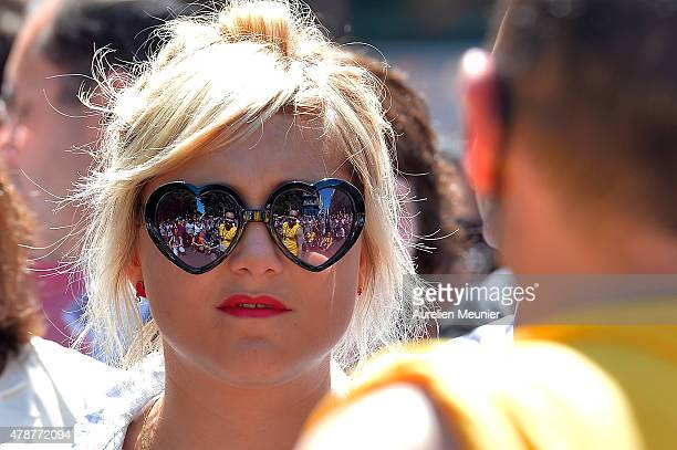 The crowd is reflect in sun glasses as thousands of people gather to support gay rights by celebrating during the Gay Pride Parade on June 27 2015 in...