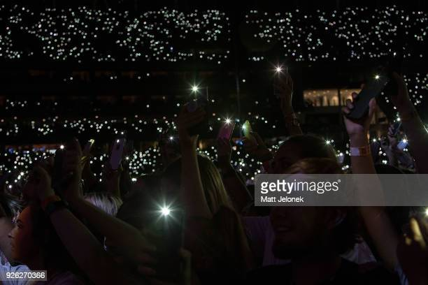 The crowd light up with their mobile devices as Ed Sheeran performs in concert on the opening night of his Australian tour at Optus Stadium on March...