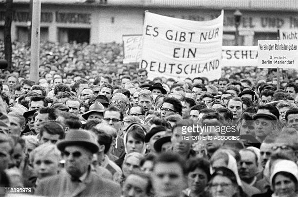 The crowd listen during Mayor of Berlin Willy Brandt's speech after the beginning of construction of the Berlin Wall on August 16 1961in BerlinGermany