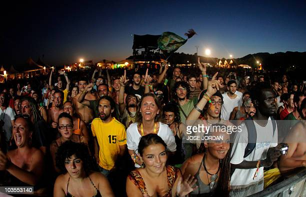 The crowd listens to performers at the Rototom Sunsplash European reggae festival in Benicasim on August 24 2010 The festival runs from August 21 to...