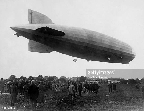 The crowd looking at the Graf Zeppelin airship taking off in October 1928 in Friedrichshafen Germany