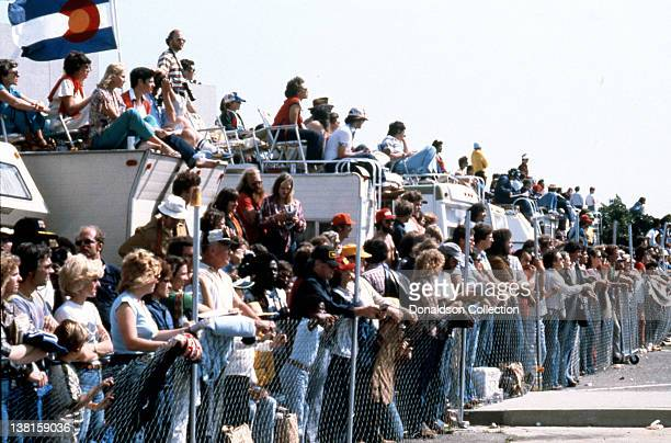 The crowd looks on as celebrity participants race indy cars on the streets during the Long Beach Grand Prix in 1979 in Long Beach, California.