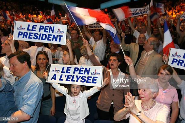 The crowd looks on as leader of the French National Front JeanMarie Le Pen delivers a speech during a party meeting where he addressed his political...