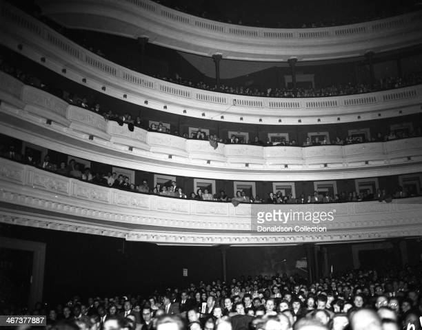 The crowd looks on as singer Billy Eckstine performs ostage at Carnegie Hall on November 11, 1952 in New York, New York.