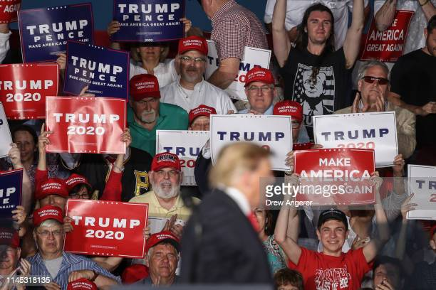 The crowd looks on as US President Donald Trump speaks during a 'Make America Great Again' campaign rally at Williamsport Regional Airport May 20...