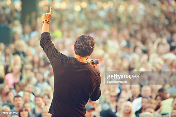 the crowd loves him! - singer stock pictures, royalty-free photos & images