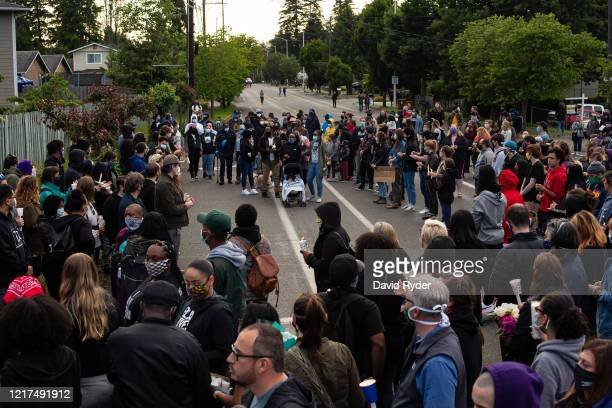 The crowd makes way for the family to enter at the start of a vigil for Manuel Ellis a black man whose March death while in Tacoma Police custody was...