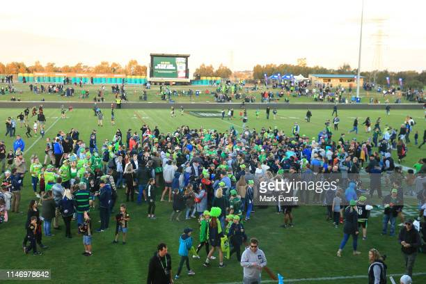 The crowd mob the Canberra players after the round eight NRL match between the Canberra Raiders and the Penrith Panthers at McDonalds Park on May 04,...