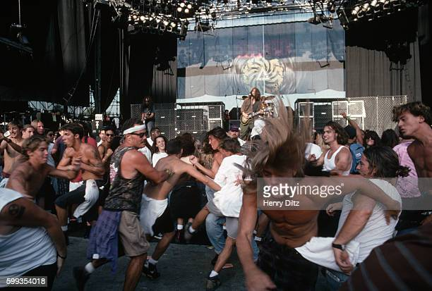 The crowd moshes in front of the stage as Soundgarden plays at Lollapalooza