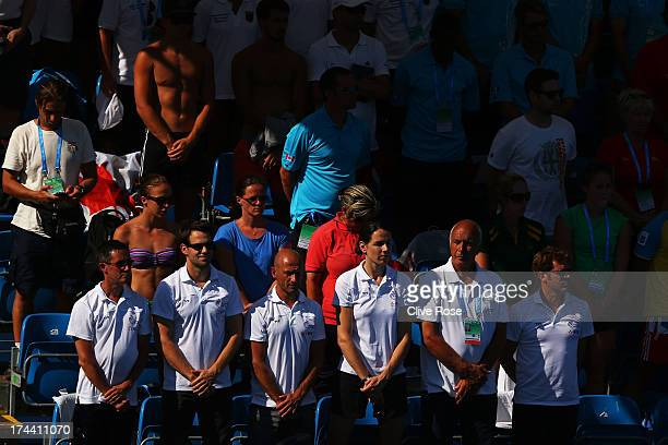 The crowd observe a minutes silence in honour of the Galicia rail derailment that killed 78 on Wednesday ahead of the Women's 10m Platform Diving...